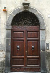 Brown door with gray frame in Orvieto