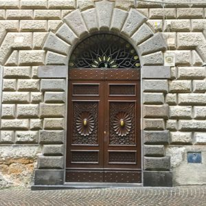 Stone wall with paneled doorway in Orvieto