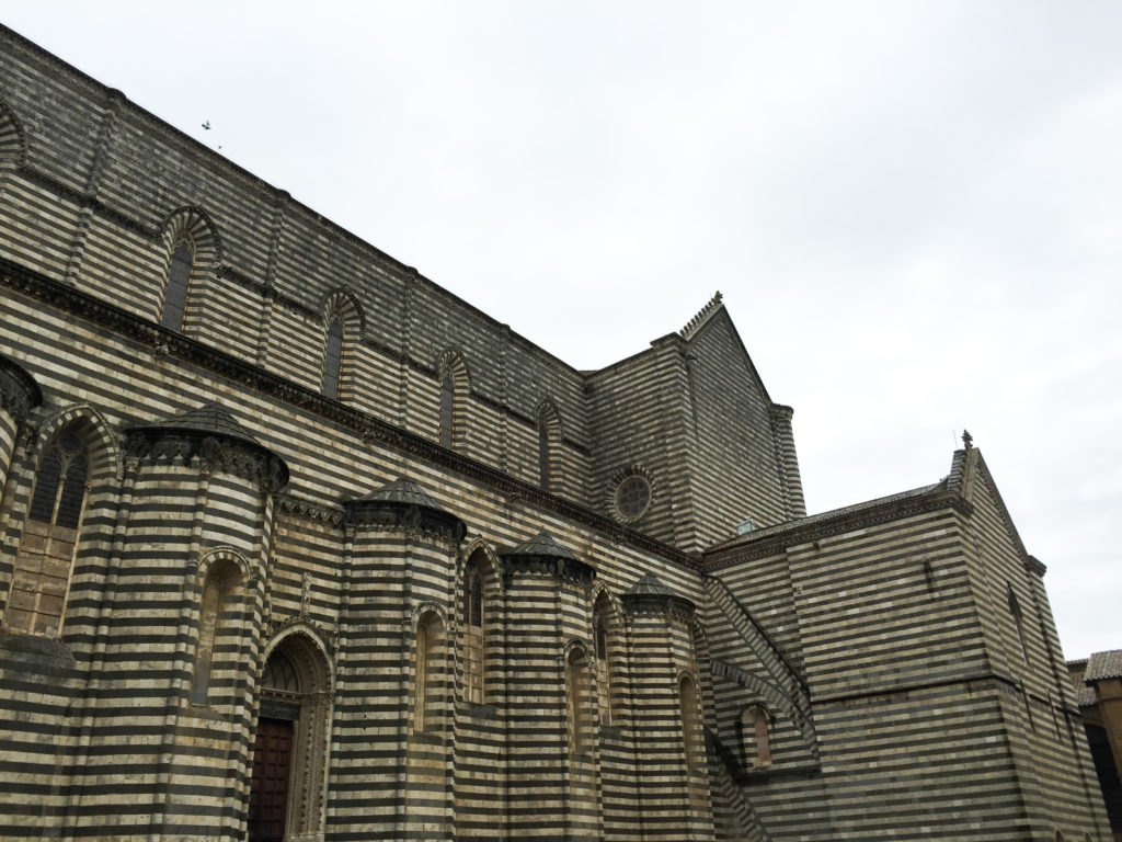 The striped exterior of the Duomo di Orvieto