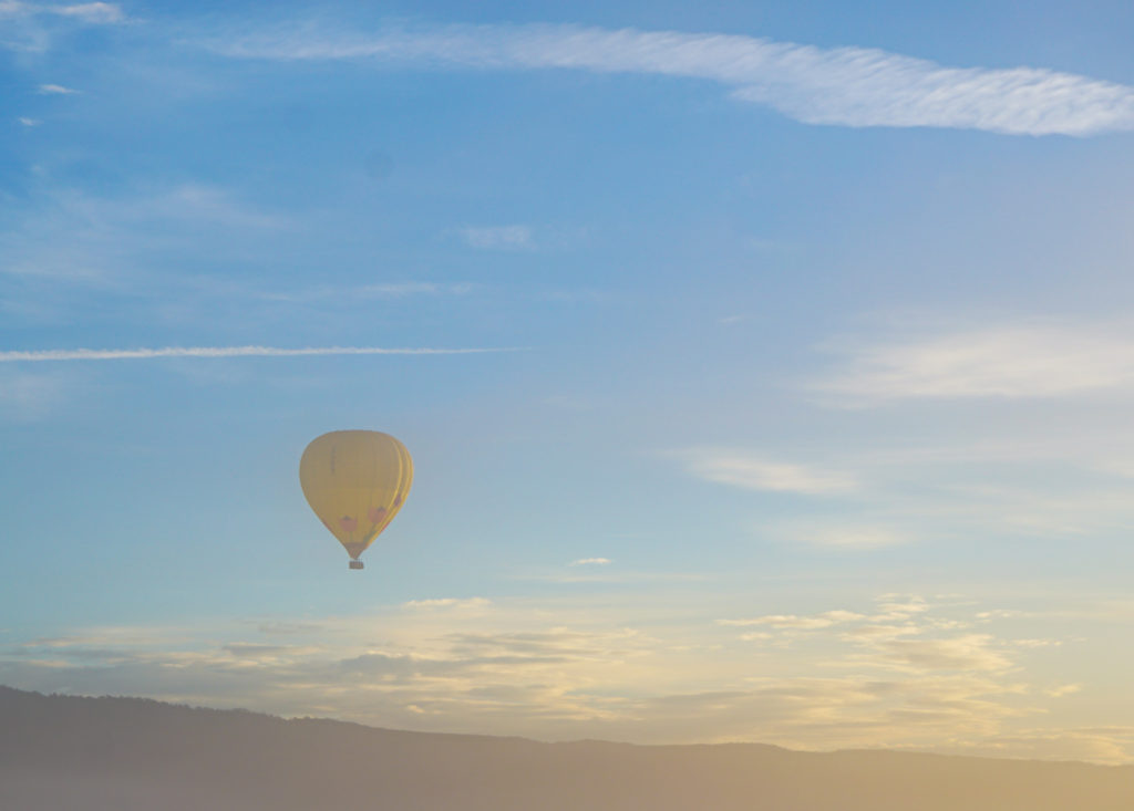 A hot air balloon on a misty morning in Yountville California