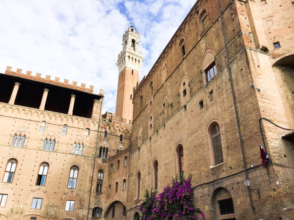 The Torre del Mangia, the bell tower at the Piazza del Campo in Siena, Italy.
