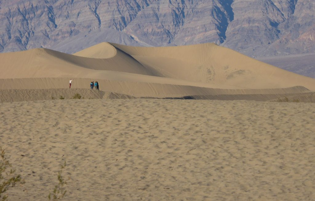 Walking out into the Mesquite Flat Sand Dunes at Death Valley National Park California