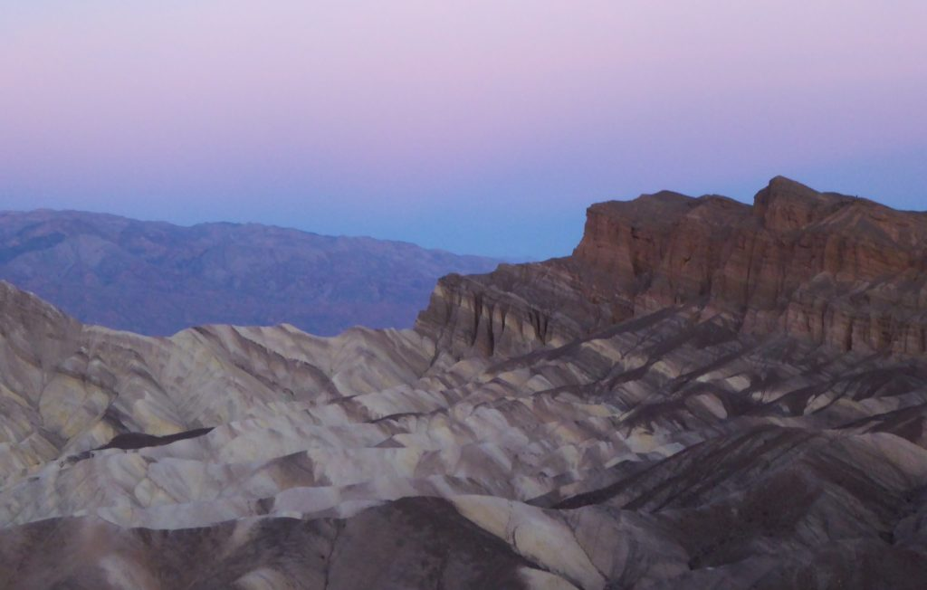 Viewing pre sunrise hues at Zabriskie Point is one of the best things to do at Death Valley National Park!