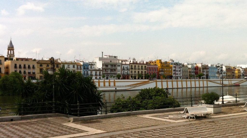 Walking by the Guadalquivir River in Seville Spain