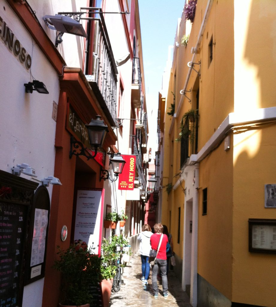 The narrow streets of Barrio Santa Cruz in Seville Spain