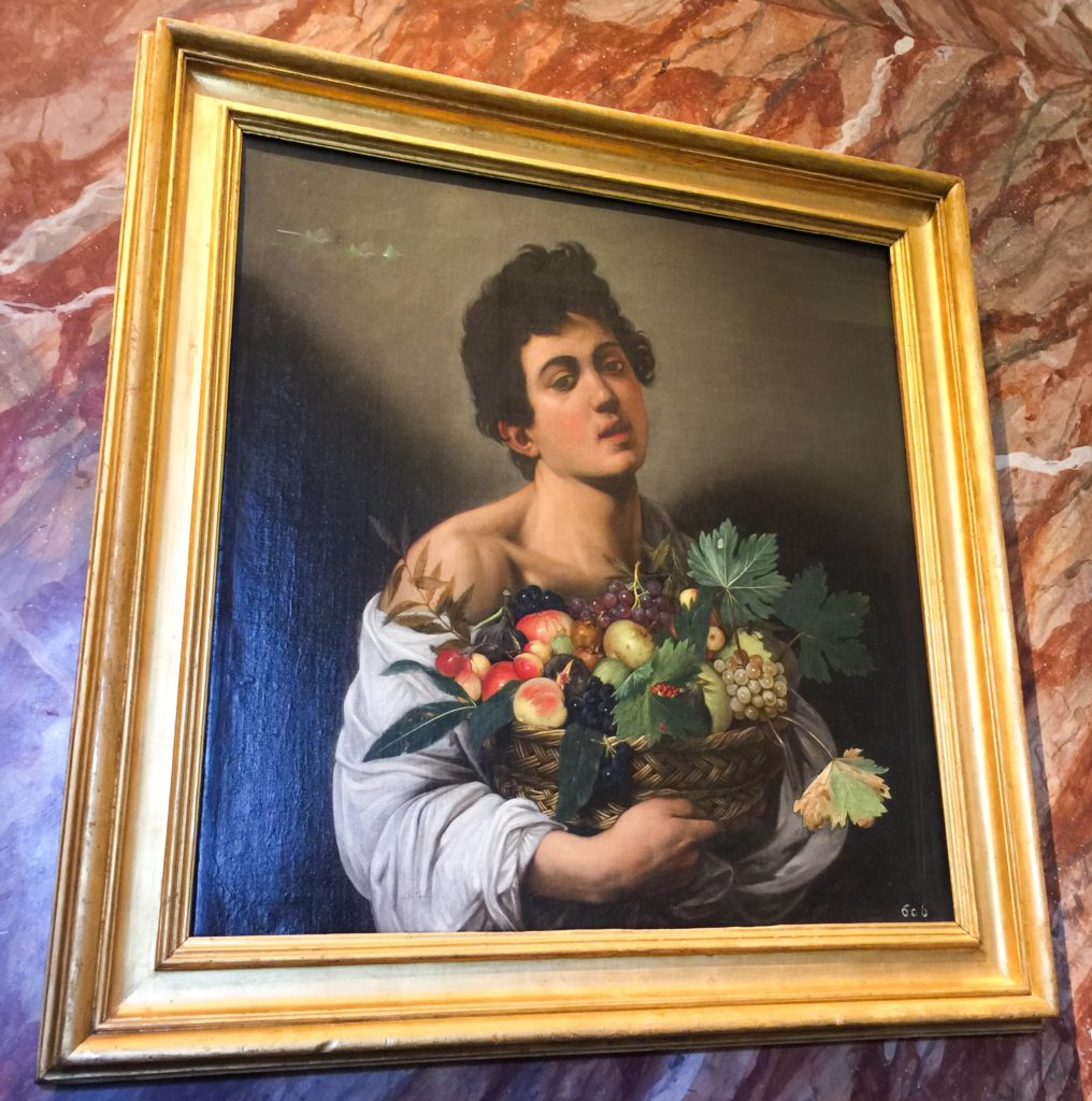 Caravaggio's Boy with a Basket of Fruit at the Borghese Gallery in Rome Italy