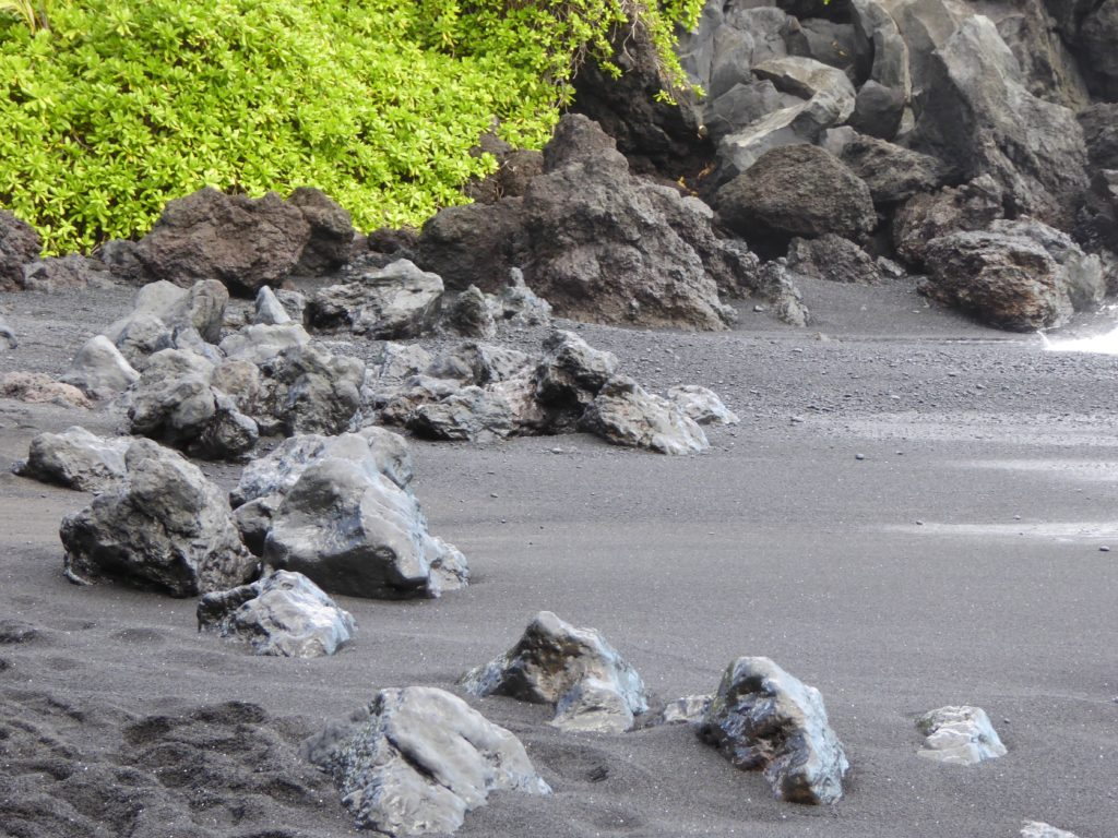 Walking on a black sand beach is one of the top things to do in Maui!