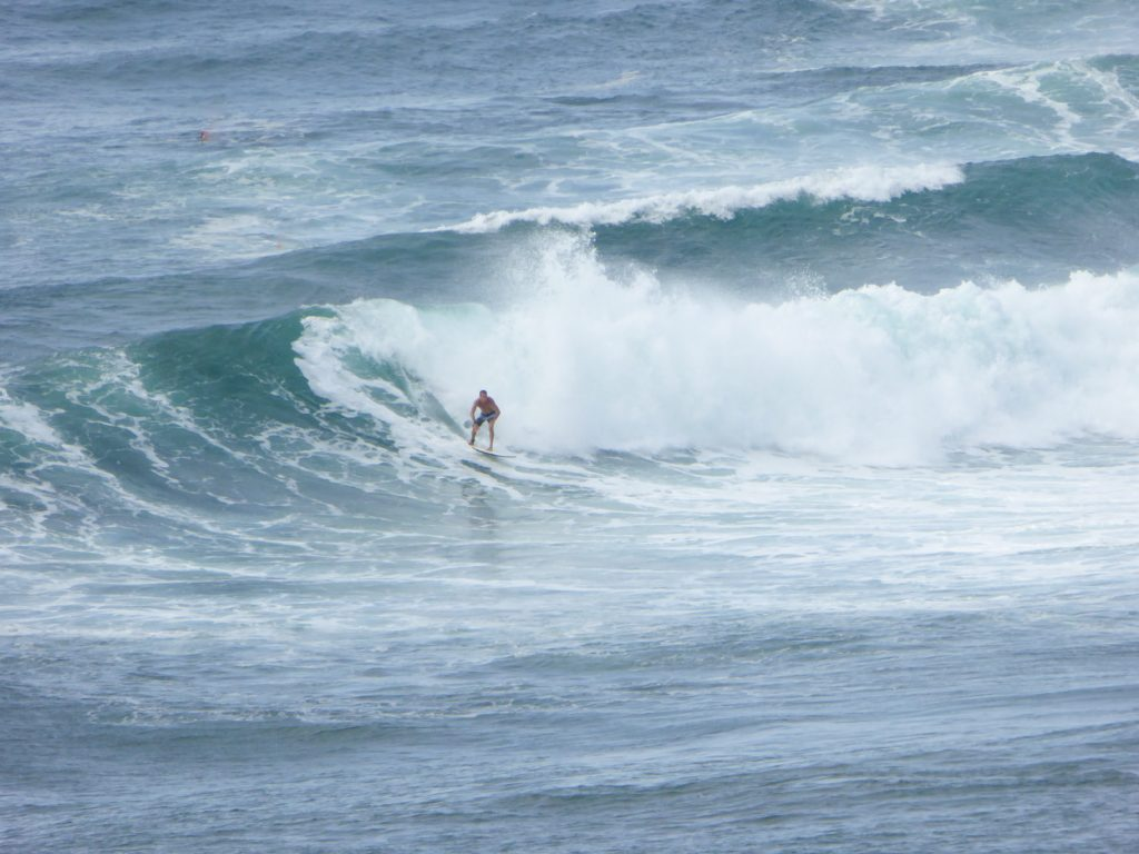 Surfer at Honolua Bay in Maui Hawaii