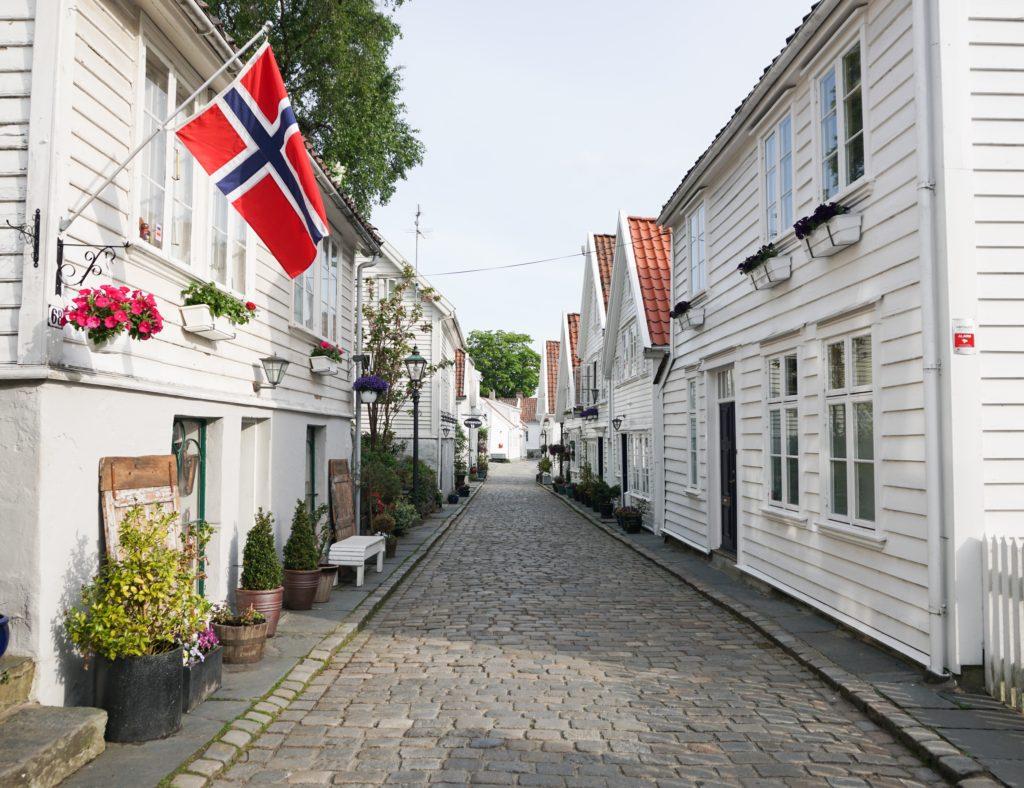 Pretty white houses line cobblestone streets in Gamle Stavanger