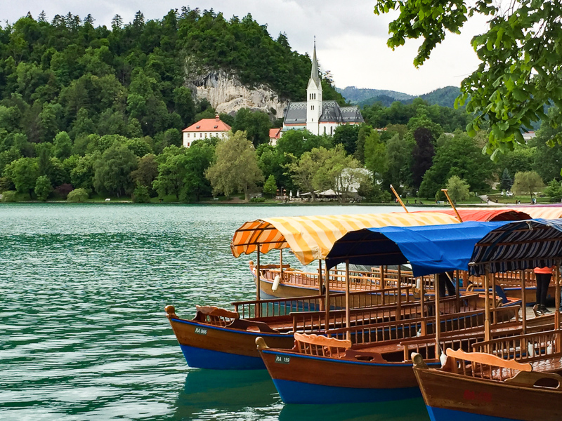 Pletna Boats docked right below Hotel Park in Lake Bled Slovenia
