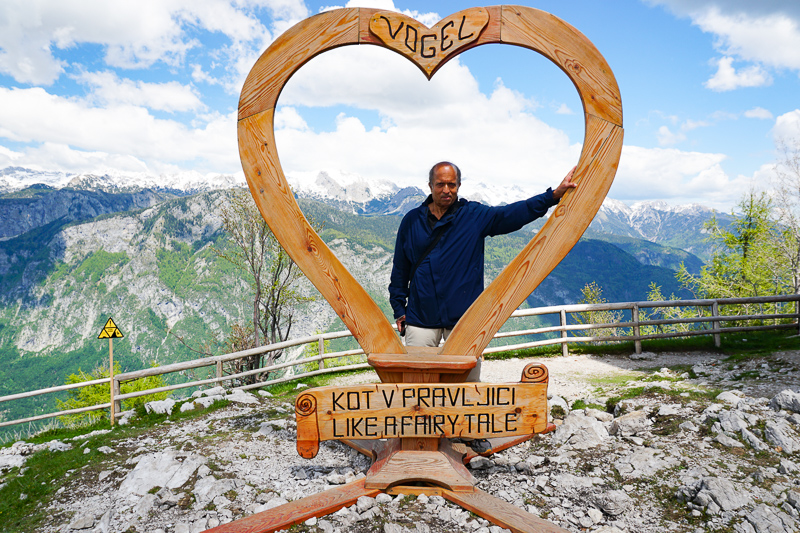 Posing for a photo at the Heart of Vogel at the top of the mountain
