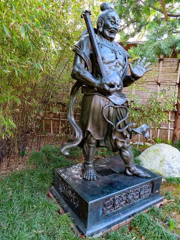 Statue of Guardian of Buddha Japanese Garden in Balboa Park, San Diego, California, USA