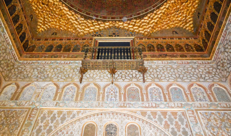 Ornate room in the Royal Alcazar in Seville, Spain