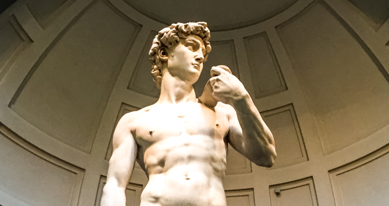 Michelangelo's David at the Accademia Gallery in Florence, Italy can be seen on a day trip from Bologna!