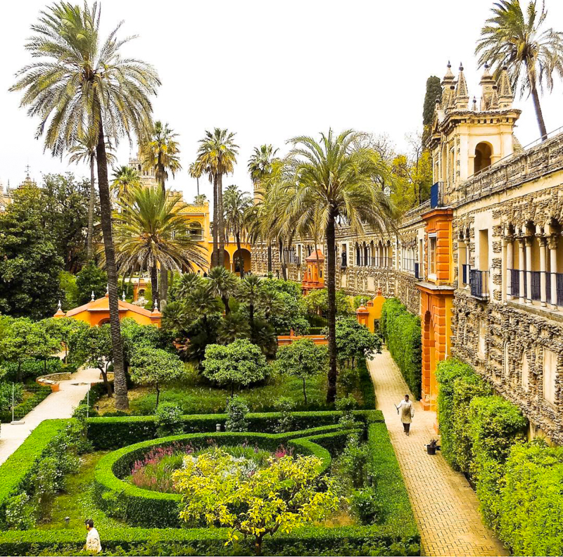 A view of the formal gardens at the Alcazar of Seville in Spain