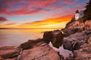 Bass harbor Lighthouse in Acadia NP at Sunset. Acadia NP is one of the best places to visit in New England.