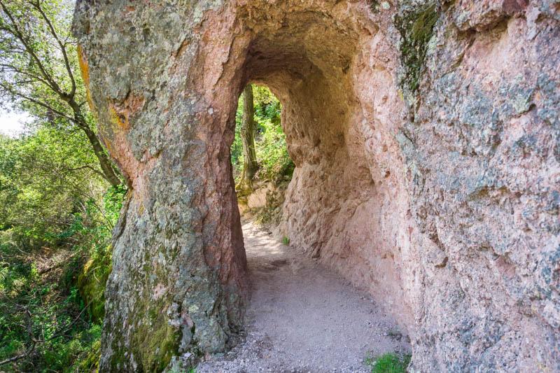 A hiking trail goes through a tunnel at Pinnacles National Park in California